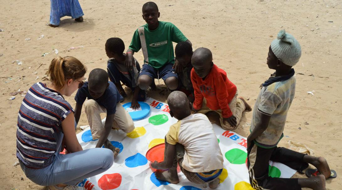 A Projects Abroad volunteer is working with children in Senegal during her High School Special summer project.